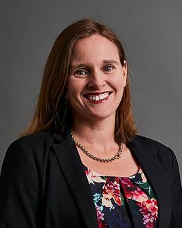 Passport photo of Alicia Carroll on grey background